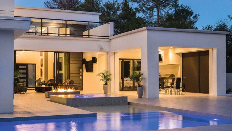 luxury home with automated lighting at night